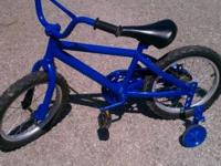 Bike for sale, blue color with training wheels. 16