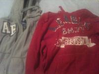 Two boys American Eagle hoodies.  One is an adult extra
