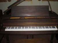Nice Brambach baby grand piano. It sounds pretty good,