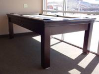 This 7' Slate pool table has a ball return (drawer on