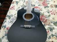 - Brand new acoustic guitar never used - Asking $75 or