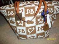 BRAND NEW AUTHENTIC DOONEY & BOURKE. RECEIVED AS A GIFT