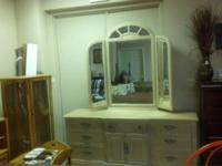 Very nice bedroom dresser with mirror and wing mirrors.