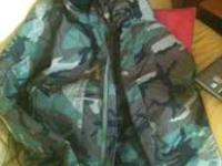 Never worn insulated camo hunting coat. Size Large.