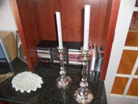 This lovely set of staggered height candlesticks would