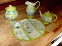 Brand new matching set.......teapot, cookie jar,