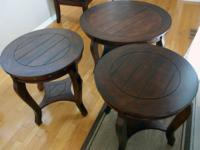 I am selling a set of wood circular coffee tables. They