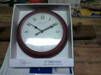 I have a brand new circle maroon clock. If interested