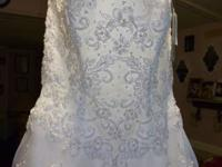 Brand new bridal gown with tags still on. Size 8. If