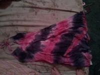 tye dyed dress still has the tags on it. size small. if