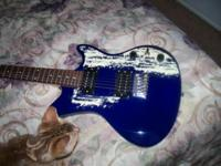 BRAND NEW GUITAR!BLUE ELECTRIC GUITAR FOR SALE. NEVER