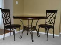 am selling an espresso circular table with 4 chairs.