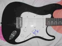 Brand New Fender Squire Guitar signed by Dave Mathews.