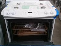 BRAND NEW WHITE FRIGIDAIRE GAS SLIDING STOVE. BAKE AND