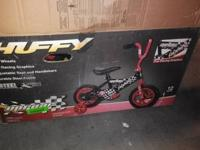 Brand New Huffy Kids Bicycle with Training Wheels. I
