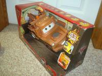 Brand new in box Large Tow Mater that talks and plays