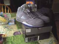 I have a brand new pair of Jordan wolf grey 5s for
