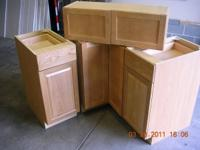 "For sale is a 36"" Lazy Susan cabinet with bi-fold door,"