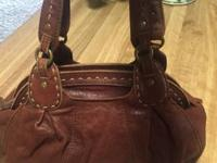 I'm selling my brand new Lucky Brand Trinity Handbag.