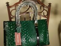 Green snake embossed genuine leather. Two sturdy double