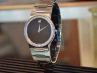 Movado style #0605852. Diamond bezel 1ctw. Stainless