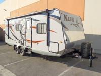 This brand new 2014 Nash 23D Travel Trailer has just