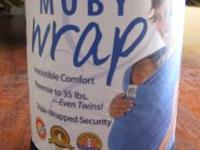 This all new black Moby wrap has never been used and is