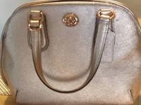 Selling a BRAND NEW, NEVER USED COACH purse. Asking: