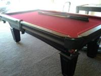 A regular sized pool table in PERFECT CONDITION. I