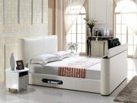 A TV bed combines the luxury of a high quality bed with