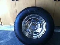 Brand new trailer tire. Size is 205-75-14. Rim is