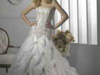 Brand new wedding dress with beautiful beading. (size 4