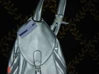 I have a brand NEW (with tags) Women's Purse / Small