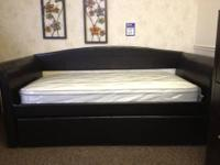 This is a very nice wood Oak finish day bed from
