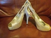 Beautiful, 3 inch high heels. Size 7 1/2 . Front of