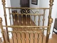 Heavy brass bed.  Double.  There are no side rails.