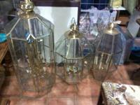 We have 4 nice metal / glass foyer lightings