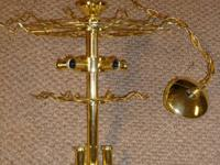 This is a beautiful brass light that measures 19 inches