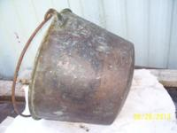 Brass hanging pot made out of brass with steel handle