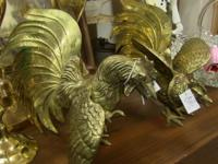 Lovely pair of detailed brass sculptures. Each measures