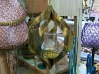 Miniature hanging glass and brass candleholder.