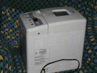 This is a good condition bread maker. It looks good and