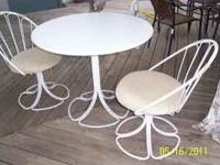 Breakfast table with two swivel chairs in good