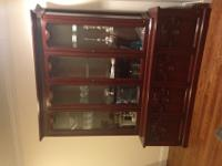 Gorgeous antique breakfront with glass shelves to