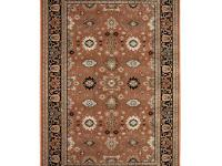 This breckon paprka area rug is in the fezzan