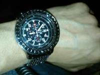 hi i have here a breitling Super Avenger All Custom i