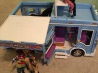 Breyer horse trailer with several horses and dolls.