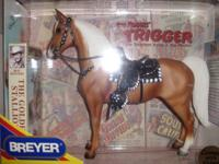 I have 2 Breyer Collectible horses, they are still in