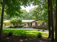 This lovely and very spacious ALL brick ranch sits in