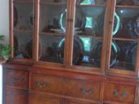 Beautiful China cabinet with secretary. Table with two